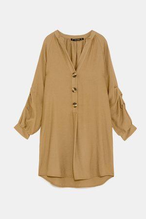 Zara Tunika se sklady na rukávu