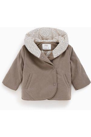 Zara Zahalující kabát