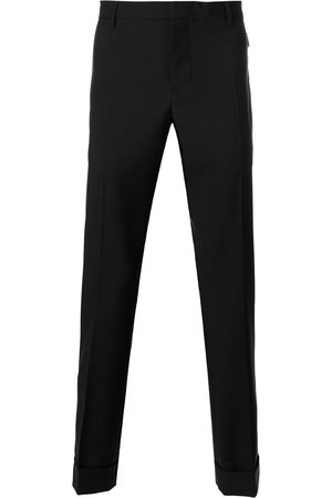 VALENTINO Trousers with zip pockets