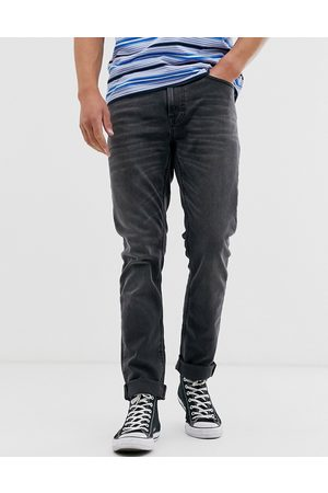 Nudie Jeans Co Lean Dean slim tapered fit jeans in mono grey wash