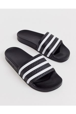 adidas Adilette sliders in black