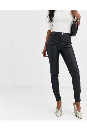 River Island Faux leather skinny trousers in black