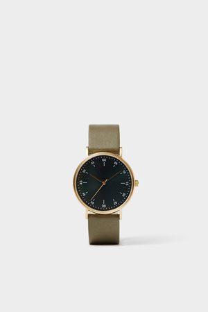 Zara Minimalistické hodinky s koženým zeleným řemínkem