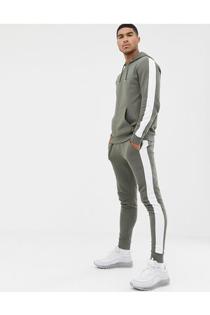 ASOS Tracksuit hoodie/skinny joggers with side stripe in khaki-Green