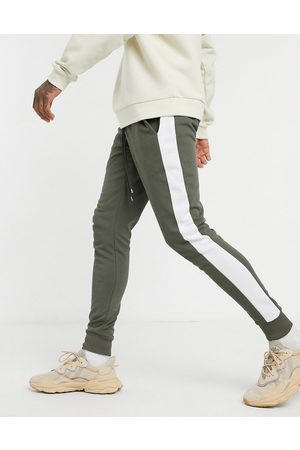 ASOS Skinny joggers with side stripe in khaki-Green