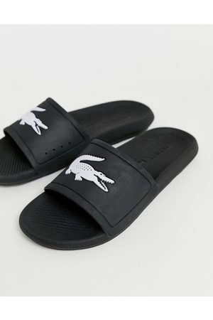 Lacoste Croco sliders in black