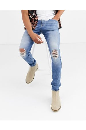ASOS 12.5oz 'Cigarette' skinny jeans in mid wash blue with busted knees