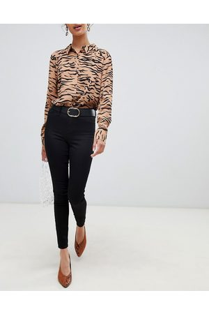 River Island Molly mid rise reform skinny jeggings in black