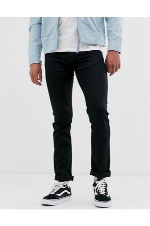 Nudie Jeans Co Grim Tim slim straight fit jeans in dry ever black wash