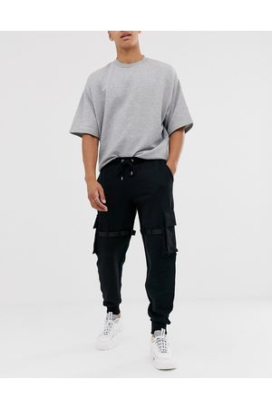 ASOS DESIGN Muži Tepláky - Utility joggers with multi pockets & strapping-Black