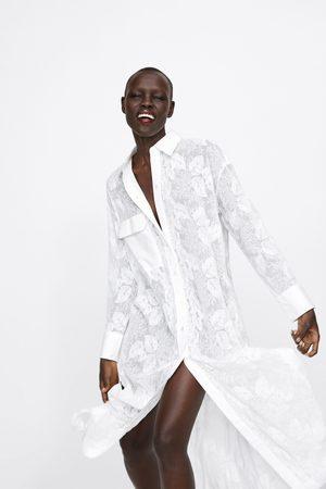 Zara Tunika s výšivkou a kapsou