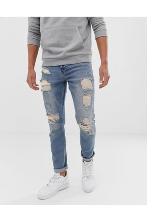 ASOS Stretch slim jeans in vintage light wash blue with heavy rips