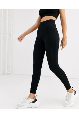 ASOS Ženy Tepláky - Basic stretch super skinny joggers in organic cotton-Black