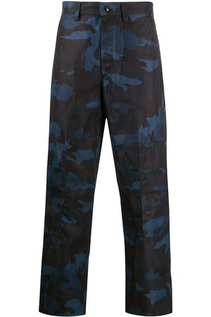 VALENTINO Technical fabric camouflage trousers