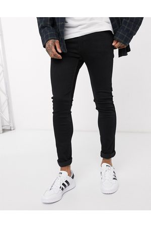 Levi's Youth 519 super skinny fit hi-ball roll jeans in stylo advanced stretch black