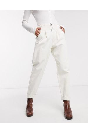 Bershka Buckle detail slouchy trouser in white