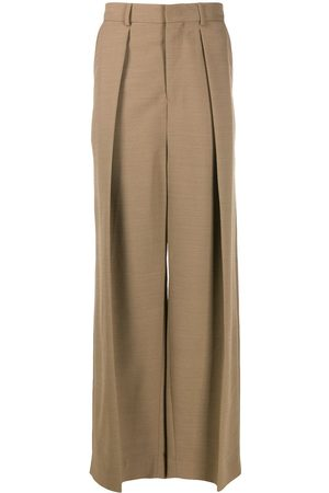 Ami Wide-fit pleated trousers