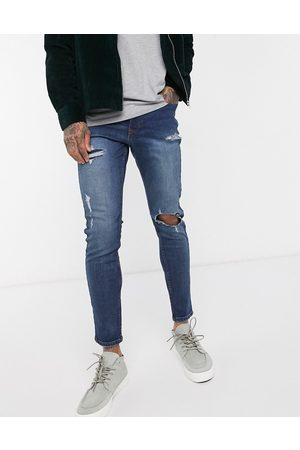 New Look Rip and repair skinny jeans in mid wash-Blue
