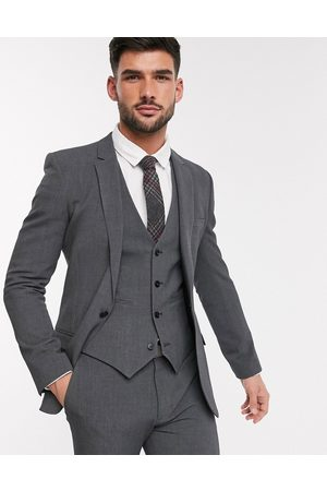 ASOS Super skinny suit jacket in four way stretch in charcoal-Grey