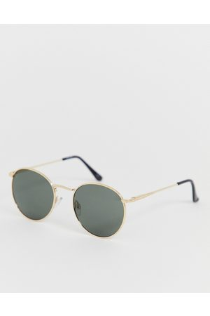 ASOS Round sunglasses in gold with nose bridge detail