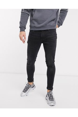 River Island Spray on skinny jeans in washed black