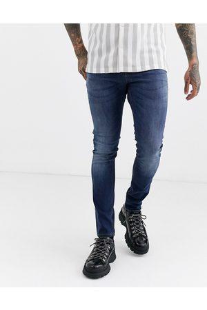 ASOS Super skinny jeans in dark wash-Blue