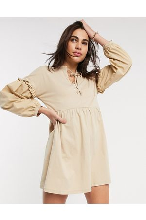 River Island Long sleeve poplin tiered mini dress in beige