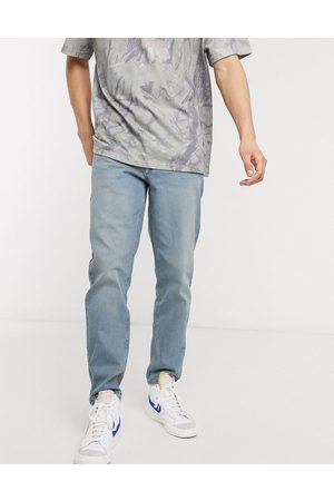 ASOS Stretch tapered jeans in light wash blue