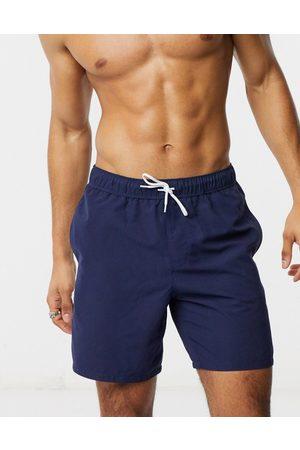 ASOS Swim shorts in navy mid length