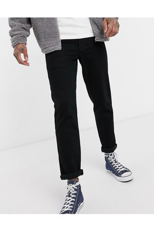 ASOS Stretch tapered jeans in black