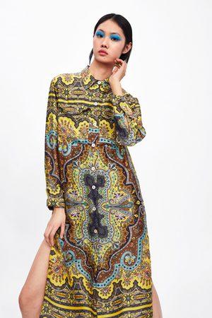 Zara Tunika s potiskem a kapsami