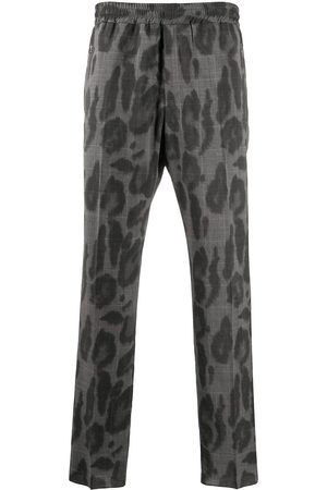Stella McCartney Leopard check print trousers