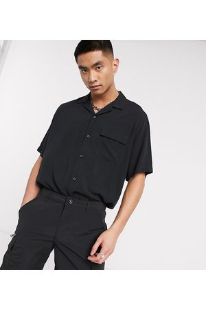 COLLUSION Short sleeve shirt in black