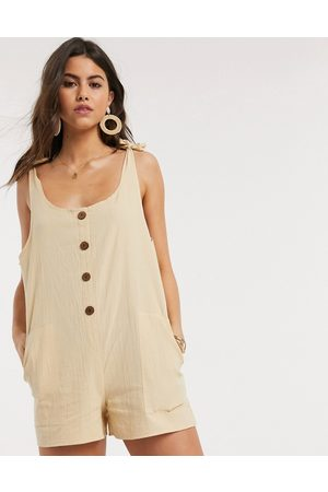 ASOS Button front dungaree playsuit in stone