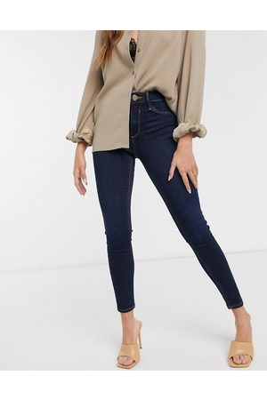 River Island Molly mid rise skinny jeans in dark wash blue