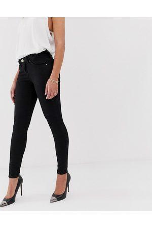ASOS Lisbon mid rise 'skinny' jeans in clean black in ankle grazer length