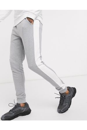 ASOS Skinny joggers with side stripe in grey marl