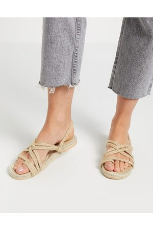 Truffle Collection Woven toe loop flat sandals in natural-Beige