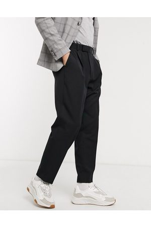 ASOS Oversized tapered smart trousers in black