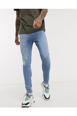 ASOS Muži Skinny - Spray on jeans with power stretch in light wash with abrasions-Blue