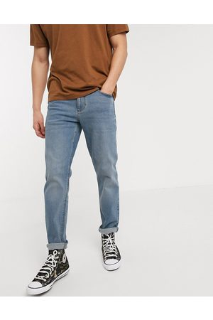ASOS Stretch tapered jeans in mid wash blue