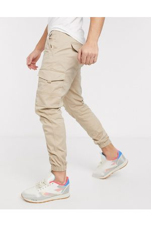 Jack & Jones Intelligence slim fit cuffed cargo trousers in light sand-Tan