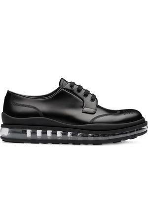Prada Brogue detail derby shoes