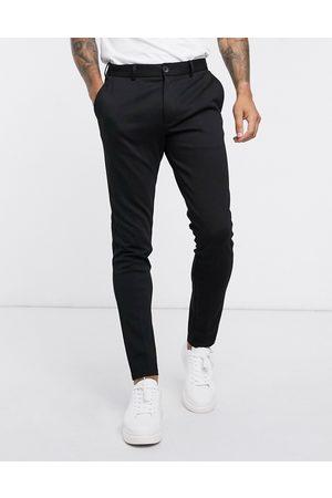 Jack & Jones Muži Chino - Intelligence slim fit jersey trousers in black