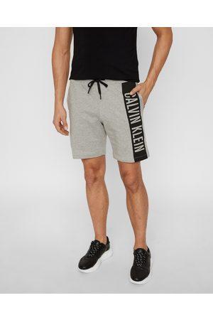 Calvin Klein Muži Šortky - Pánské šedé šortky Jersey