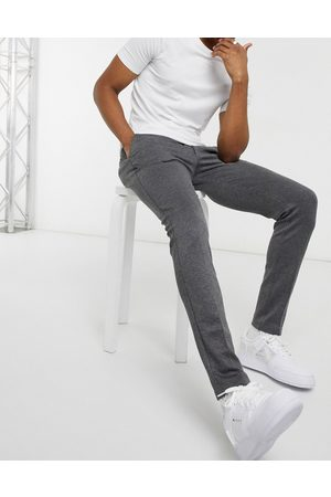 Jack & Jones Intelligence slim fit jersey trousers in grey