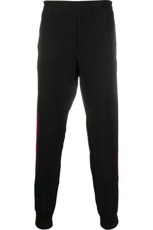 Alexander McQueen Muži Tepláky - Side stripe track pants