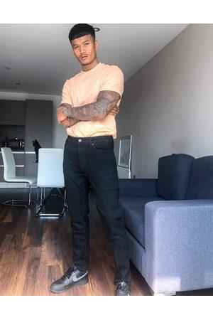 Bershka Slim fit jeans in black