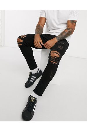 ASOS Cropped skinny jeans in black with heavy rips