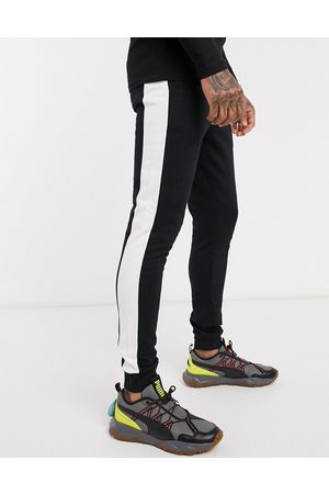 ASOS Skinny joggers with side stripe in black